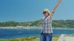 Steadicam shot: Young woman enjoys relaxing in the Mediterranean resort. Stock Footage