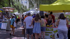 Lemonade booth with shoppers gathering Stock Footage