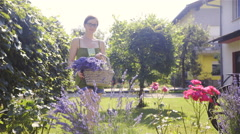 Woman with lavender under hand stand on beautiful garden 4K Stock Footage