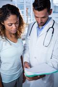 Physiotherapist explaining diagnosis to female patient Stock Photos