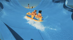 Kirillovka, Ukraine - Two girls go down on an inflatable circle Stock Footage