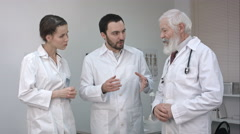 Fast meeting. Three confident doctors discussing something Stock Footage