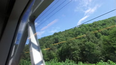 View from the train to the beautiful green landscapes Stock Footage