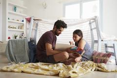 Father And Daughter Playing Indoors In Home Made Den Stock Photos