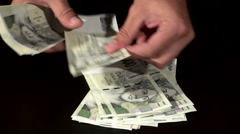 Counting Czech 2000 banknotes on a black table. Stock Footage