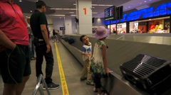 Passenger of aircraft awaiting for luggage at the airport Stock Footage