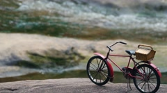 Toy bike on nature wallpaper background Stock Footage