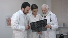 Group of doctors checking an MR exposure Stock Footage