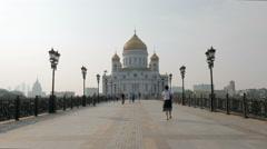Townsfolk are walking on Patriarshy Bridge near Cathedral Stock Footage