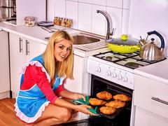 Woman bake croissants . Stock Photos