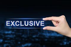 Hand clicking exclusive button Stock Photos
