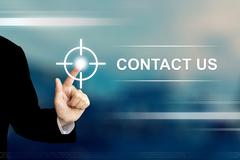 Business hand clicking contact us button on touch screen Stock Photos