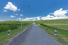 Road on the Lam Mun Bon Dam, Nakhon Ratchasim, Thailand Stock Photos