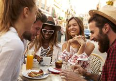 Friends on vacation having fun outside a cafe in Ibiza, close up Stock Photos