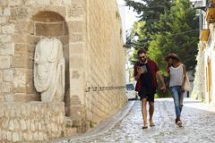 Couple on holiday walk, reading a guidebook, Ibiza, Spain Stock Photos