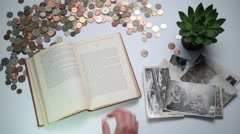 Closeup woman's hand turning page of vintage book Stock Footage