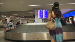 Passenger awaiting for the luggage at the airport Stock Footage