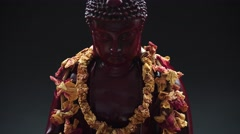 The statue of Buddha with incense. Buddhism and its symbols, Shakyamuni Buddha. Stock Footage