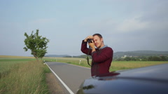 Young man photographing nature on mirrorless camera Stock Footage