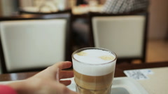 Close-up hand and glasses of woman drinking a cup of latte. Breakfast. Stock Footage