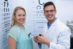 Portrait of female patient and optometrist Stock Photos