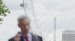 Businessman on a mobile phone in the city of London Stock Footage