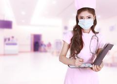 Female nurse writing medical report in hospital Stock Photos