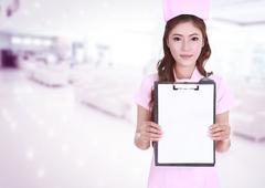 Female nurse show blank clipboard in hospital Stock Photos