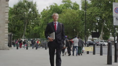 Businessman walking in the city of London Stock Footage