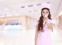 Female nurse with stethoscope in hospital Stock Photos