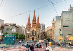 MELBOURNE - OCTOBER 2015: Federation Square at night. The city attracts 10 mi Stock Photos