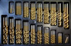A furniture workshop. Drill bits arranged in size order, in a tray. Stock Photos