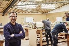 Two people working in a furniture workshop Stock Photos