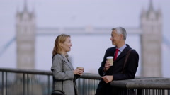 Two people talk whilst discussing business development ideas. Stock Footage