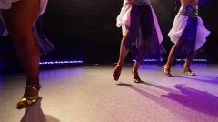 Young women in traditional Jewish dress dancing on stage Stock Footage