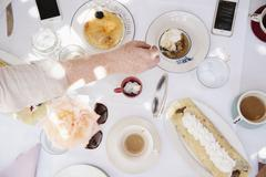 Food and drink, deserts, pancake with cream, and cups of hot drinks. Stock Photos