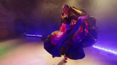 Young woman dancing in a long skirt on scene Stock Footage