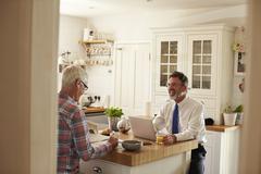 Male couple talking over breakfast, three quarter length Stock Photos