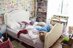 View Of Untidy Girl's Bedroom Stock Photos