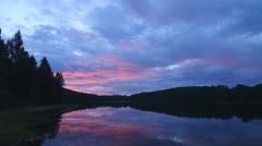 Colourful pink and blue sunrise over a freshwater lake. Ontario, Canada. Stock Footage