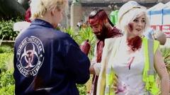 Slower, Vertical, dynamic shot of Birmingham Zombie Walk participants Stock Footage