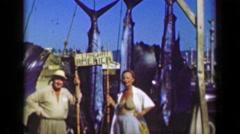 1952: Married fishing couple show off sailfish marlin billfish trophy catches.   Stock Footage