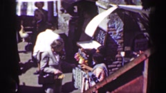 1951: Native women merchant selling handmade textile clothing goods in city Stock Footage