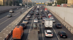 Traffic jam on multiband road in modern russian city in summer evening Stock Footage