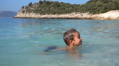 Two and a half years boy swims in the sea Stock Footage
