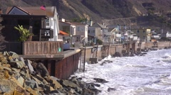 Huge waves and surf crash into Southern California beach houses during a very Stock Footage