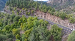 Aerial of traffic on a mountain switchback road Stock Footage