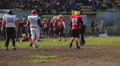 End of match half in American football, rival teams exchanging sides of field HD Footage