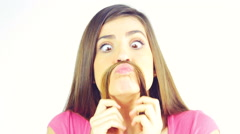 Cute girl making moustache with long hair laughing looking camera Stock Footage