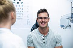 Smiling patient in ophthalmology clinic Stock Photos
